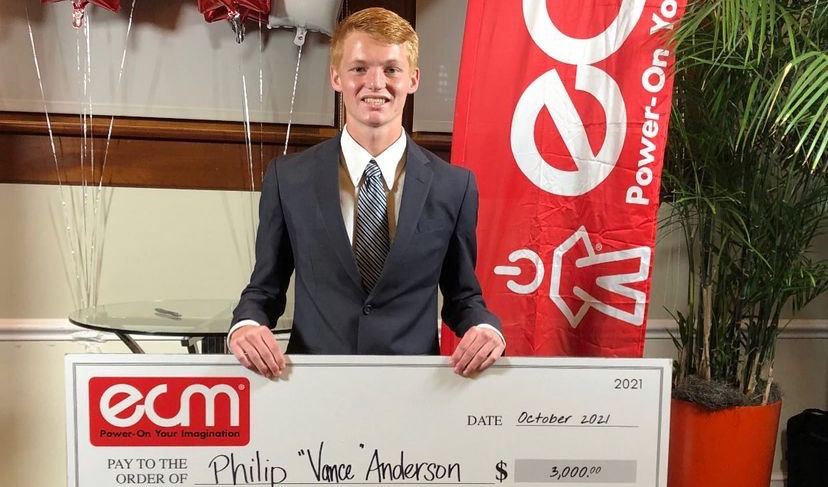 Vance standing with his check.