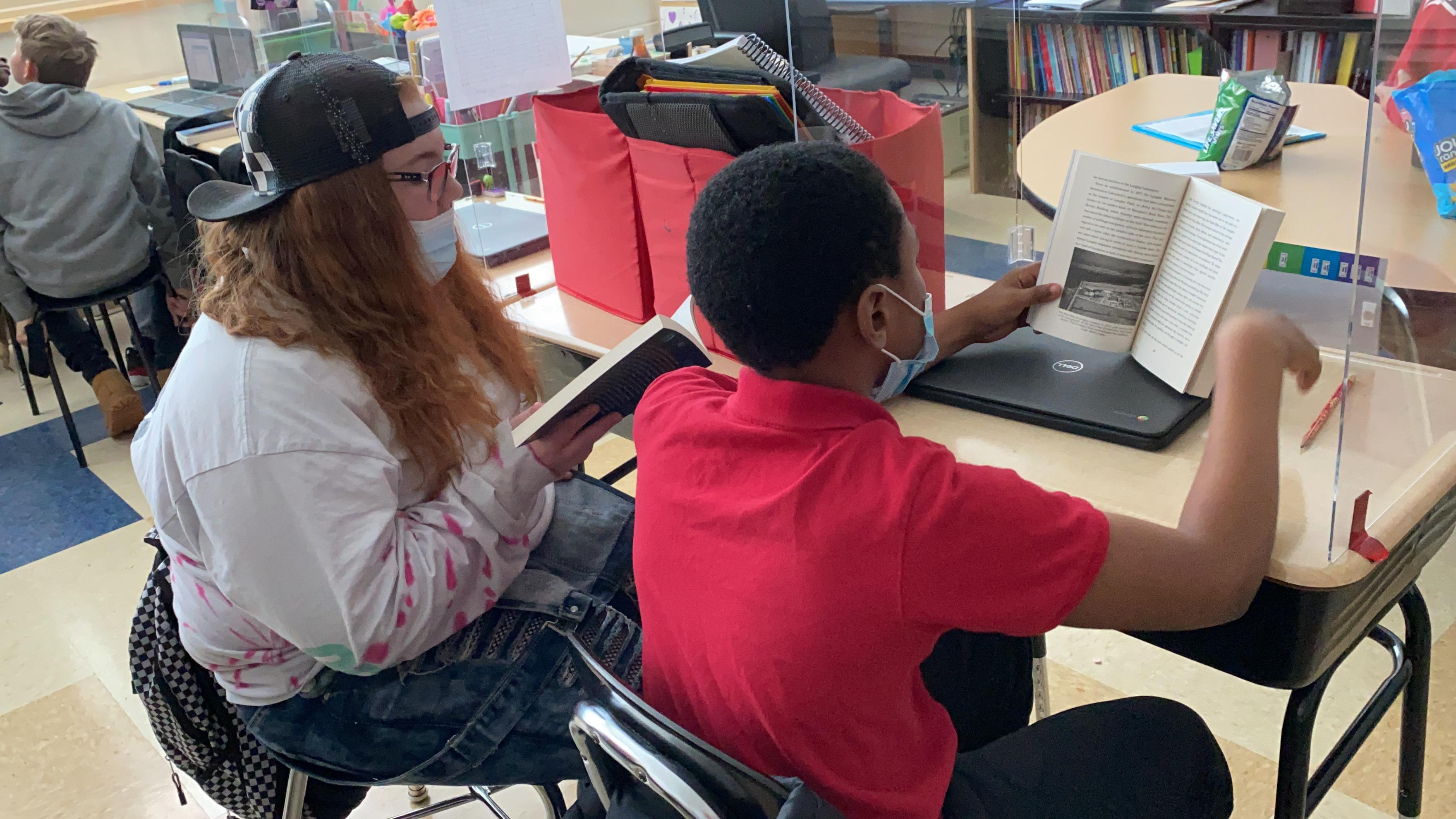 students reading literary books